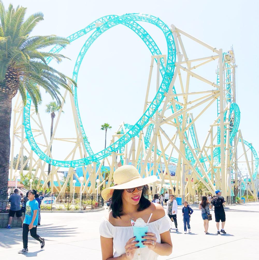 Girl holding blue HangTime milkshake in front of Hangtime - livingmividaloca.com
