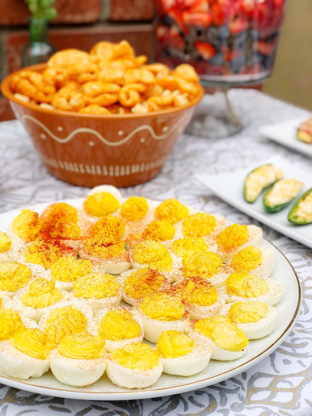 deviled eggs and pork rinds on table - livingmividaloca.com