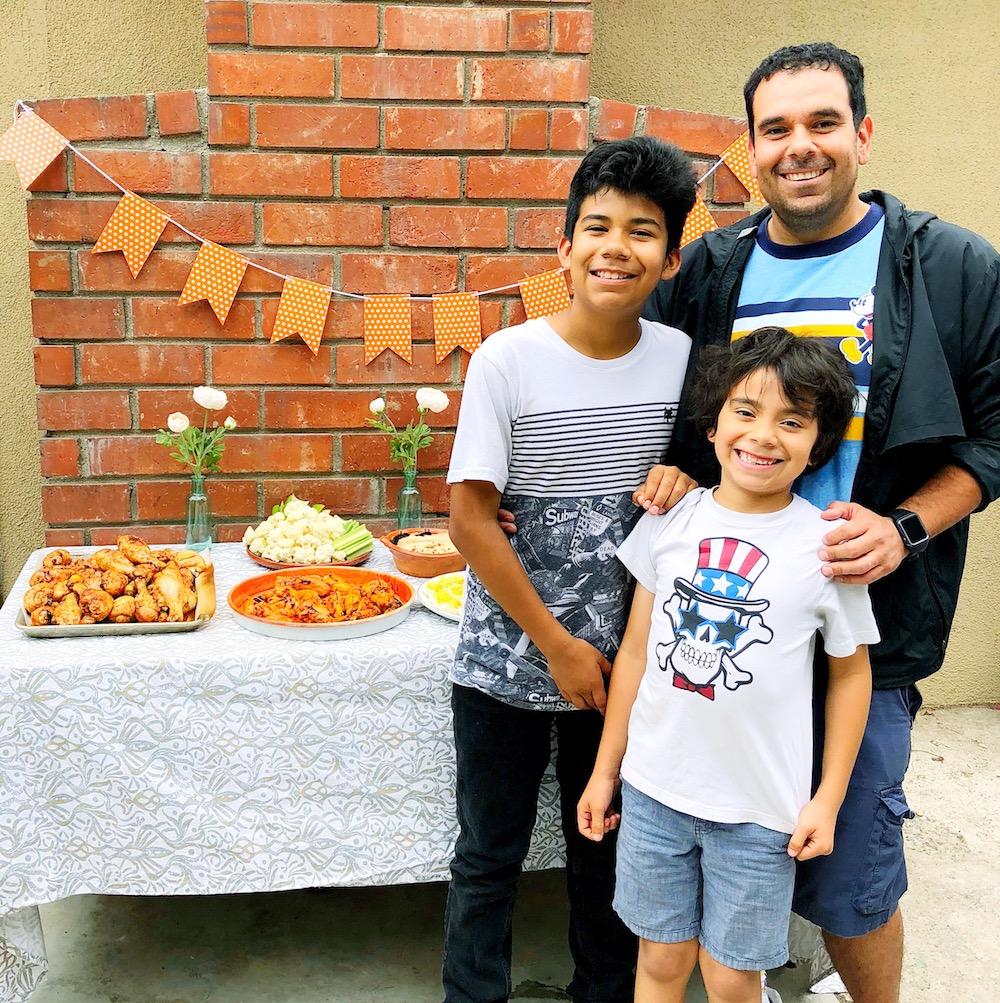 Family enjoying keto friendly foods at home - livingmividaloca.com