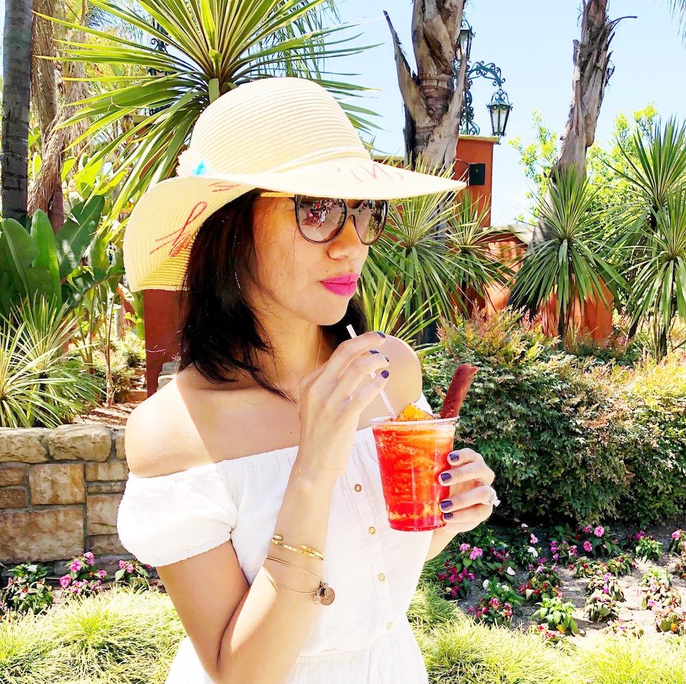 Girl drinking new mango chamoy icee with tajin topping - livingmividaloca.com