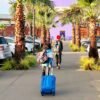 Boys carrying luggage traveling to Mexico via CBX - livingmividaloca.com - #LivingMiVidaLoca #LMVLSoCal #CBX #FamilyTravel
