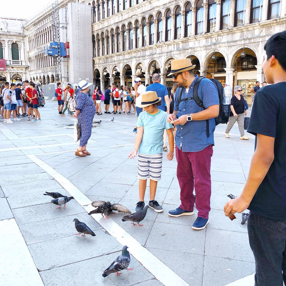 Feeding pigeons in Venice Italy
